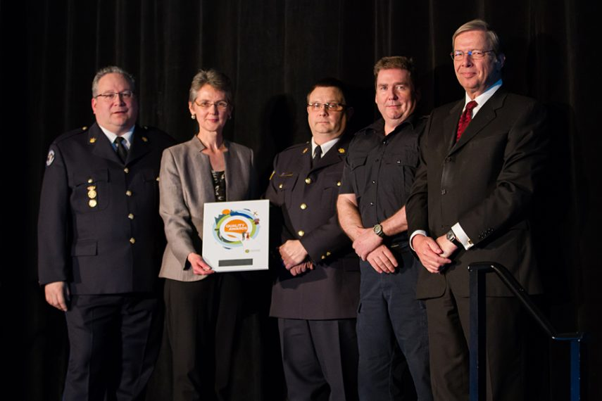 Members of the Emergency & Health Services Commission's Clinical Education Development Team accepting their plaque from BCPSQC Chair Doug Cochrane at Health Talks