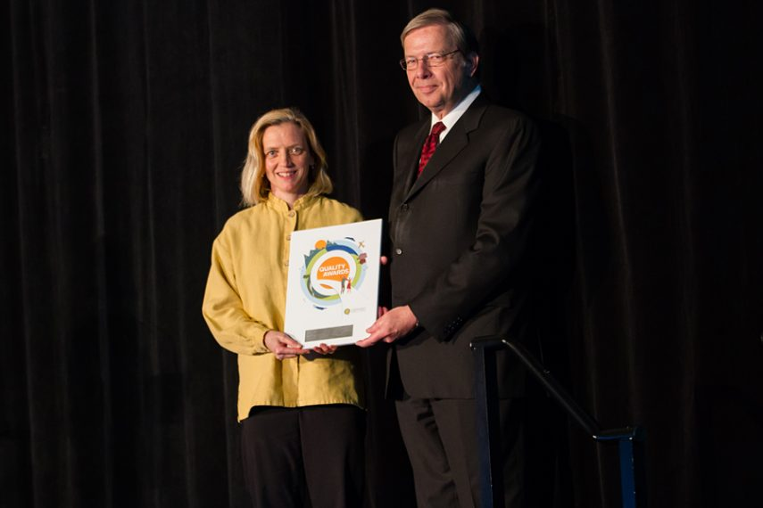 Claire Mackelson accepting her plaque from BCPSQC Chair Doug Cochrane at Health Talks