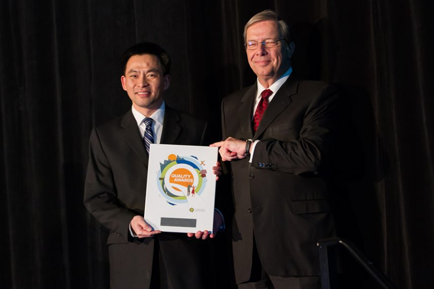 Dennis Jang accepting his plaque from BCPSQC Chair Doug Cochrane at Health Talks