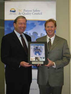 Dr. Julian Marsden (right) receives the 2009 Leadership in Quality and Safety Award from Dr. Doug Cochrane, BCPSQC Chair.