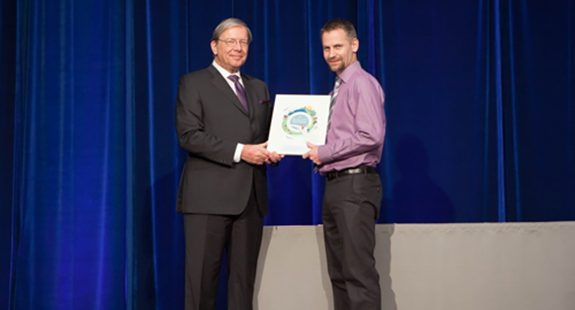 Bas Kervel accepting his plaque from BCPSQC Chair Doug Cochrane at Health Talks